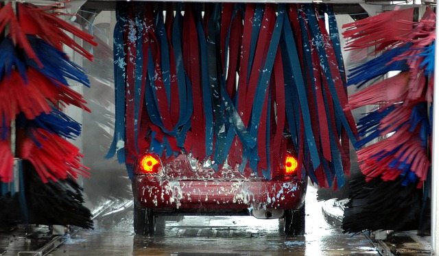 Picture of a car wash machine washing a car