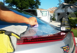 Mobile detailing services car clay bar application on vehicle